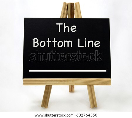 The BOTTOM LINE concept presented on chalkboard with wood easel.