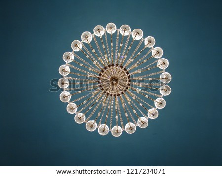 The bottom view image of the chandelier in the style of Art Nouveau.  Unique classical empire chandelier. Modern style background for a monitor.
