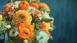 The bouquet of different orange flowers