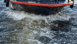 the bow of the boat. it goes at a high speed. splashes from the wave. a yacht in motion on a walk on the water
