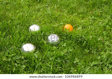 The bowls  balls on a green grass.