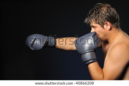 The boxer. The young man in boxing gloves