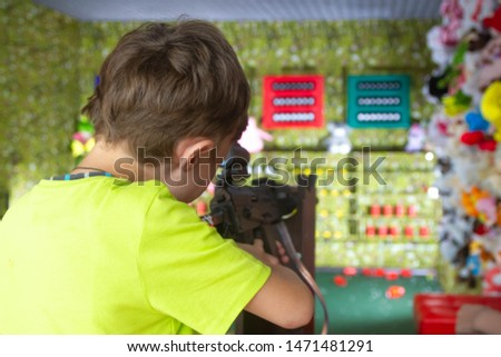 The boy aims at the target in the dash #1471481291