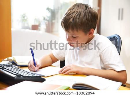 The boy behind a desk...