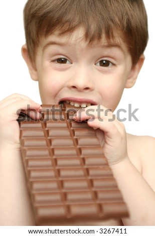 The boy bites a chocolate tile