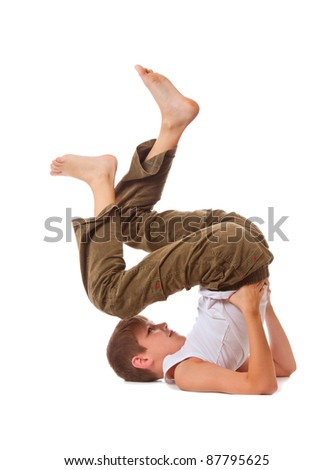 The boy carries out gymnastic exercise, on white background