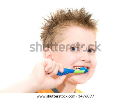 The boy cleaning teeth. Isolation on white.