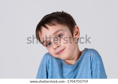 The boy confused shrugs his shoulders. He is confused (concept of human behavior).