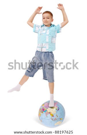 The boy costs on the globe. On white background.