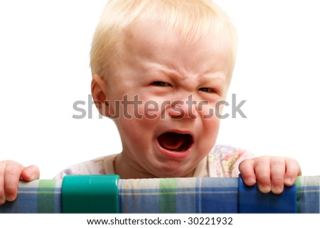 The boy cries of resentment. Isolated on a white background.