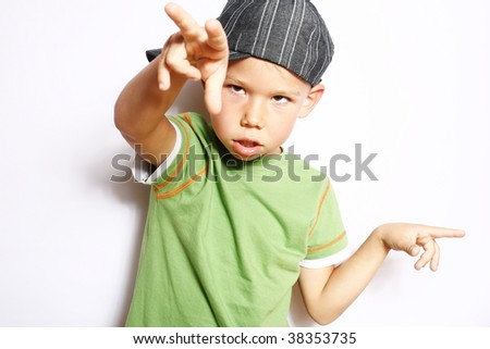 The boy dancing and gesticulating by hands.