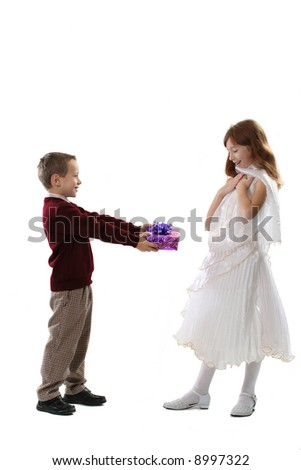 The boy gives a gift to the favorite girl