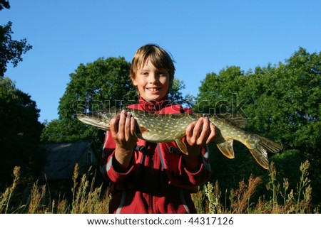 The boy has caught a pike
