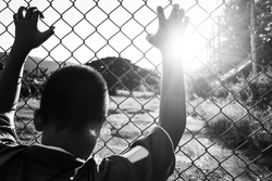 the boy holding the cage, imprisoned, retarded, Child Abuse in white tone