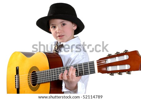 The boy in a hat plays a guitar