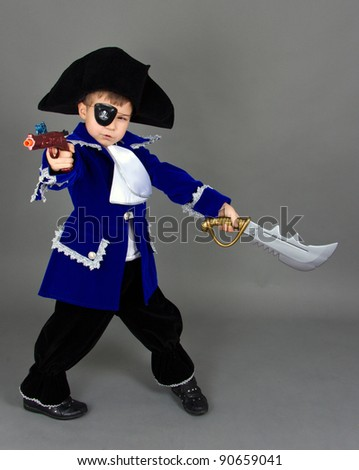 The boy in a suit of the pirate, aims from a gun