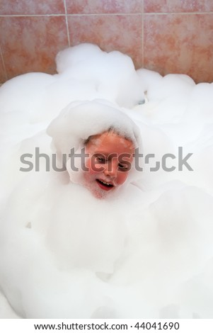 The boy in bath the filled foam
