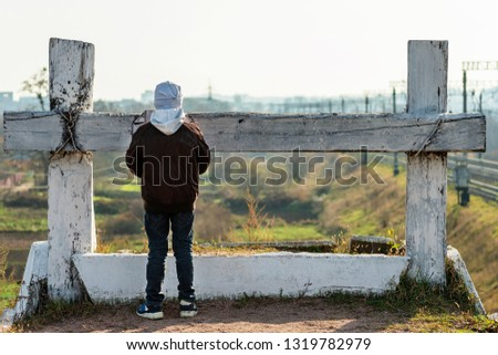 The boy in front of a dead end. Concept Teenager in a predicament. The child at the deadlock. Concept Impasse.