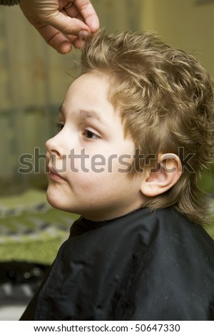 The boy in the barber shop, he gets the hair