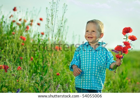 The boy in the field with a bouquet