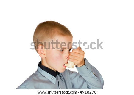 The boy injects an inhaler on an isolated background
