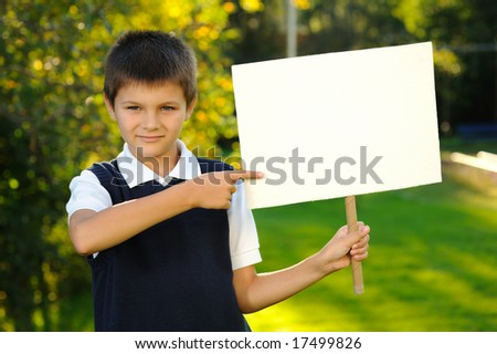 The boy is holding a white blank board