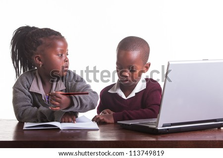 The boy is not really listening to his friend about the homework. - stock photo