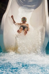 The boy is rolling with a water slide at a water park in Little Rock