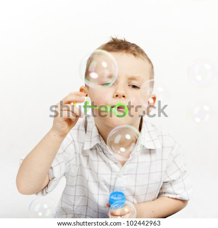 The boy lets go soap bubbles.