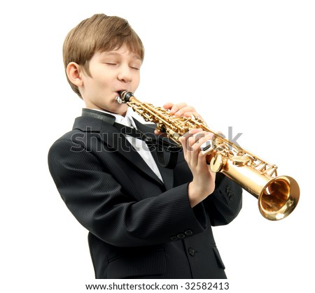 The Boy performs jazz on Soprano Saxophone.