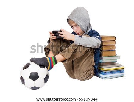 The boy plays a computer game on the games console