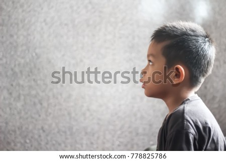 The boy.  The boy sat staring at the wall while waiting for a friend to go play. - Shutterstock ID 778825786