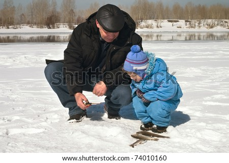 The boy, the child with the father on on winter fishing