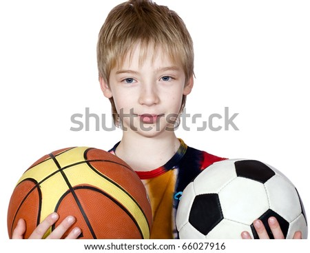 The boy tries to make a choice between basketball and football