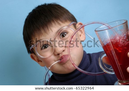 The boy wearing spectacles from plastic tubes on which the drink runs