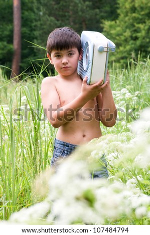 The boy  with old radio receiver at nature