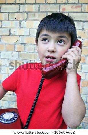 The boy with old telephone