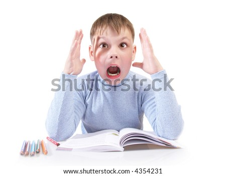 The boy with the book behind a table on a white background
