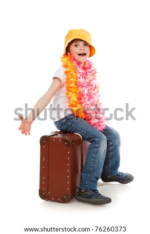 The boy with the Hawaiian wreath sits on a suitcase. Travel, rest