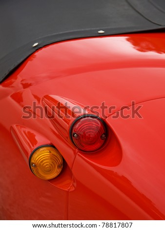 The brake and directional lights of a classic automobile