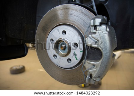 The braking system of a modern car. Brake Disc. Brake Caliper. Close-up. #1484023292