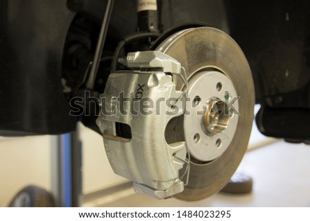 The braking system of a modern car. Brake Disc. Brake Caliper. Close-up. #1484023295