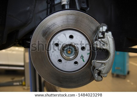 The braking system of a modern car. Brake Disc. Brake Caliper. Close-up. #1484023298