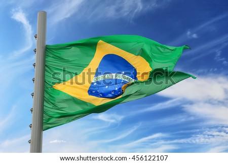 The Brazilian flag against the blue sky
