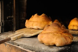 The bread of Matera, Pane di Matera, has the shape of a croissant and is produced with the exclusive use of durum wheat semolina. Matera bread just baked in a wood oven