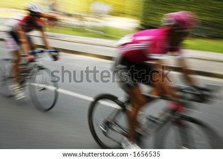 The break away. The cyclists riding by at the bicycle race Around Denmark 2006. - stock photo