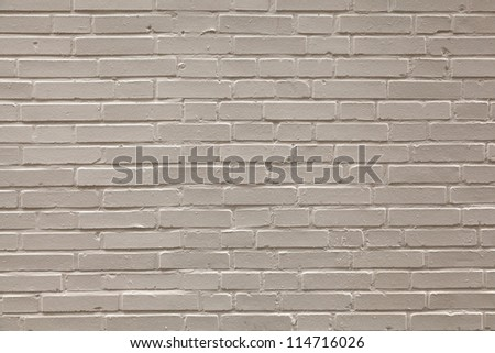 The brick wall is painted with white paint