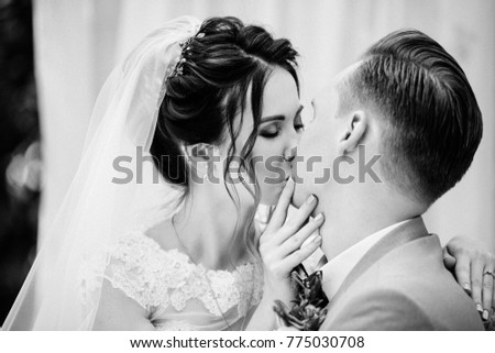 7d621bb24c3 The bride and groom are sitting on a beautiful couch in a gazebo in the  garden · Happy young couple in black dress ...