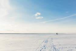 The bride and groom are walking in the snow, minimalism