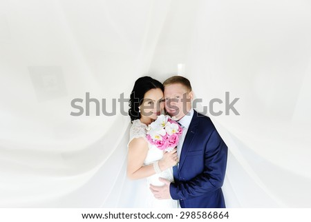 the bride and groom on a white background. the bride with a wedding bouquet of orchids